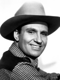 Gene Autry smiling in Westerner Outfit Photo by  Movie Star News