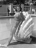Rita Hayworth Leaning on Large Clam Shell Photo by  Movie Star News