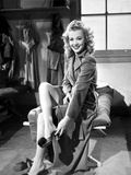 Carole Landis on a Coat Undressing Shoe Photo by  Movie Star News