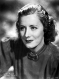 Irene Dunne on Blouse sitting Portrait Photo by  Movie Star News