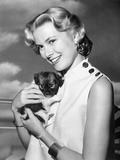 Grace Kelly Carring Cute Puppy Portrait Photo by  Movie Star News