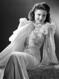 Anne Baxter on a Ruffled Dress sitting Photo by  Movie Star News
