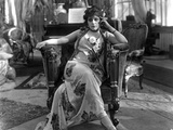 Theda Bara on Printed Dress and sitting Photo by  Movie Star News