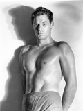 Johnny Weissmuller standing in a Portrait Photo by  Movie Star News