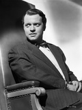 Orson Welles Seated in Coat and Bowtie Photo by E Bachrach