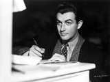 Robert Taylor Writing on Paper in Suit Photo by  Movie Star News