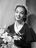 Ann Blyth Carrying a Flowers and smiling Photo by  Movie Star News
