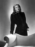 Ingrid Bergman standing in a Black Dress Photo by E Bachrach