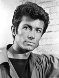 George Chakiris Posed in Black and White Photo by  Movie Star News