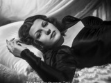 Rita Hayworth Lying on Bed in Black Gown Photo by A.L. Schafer