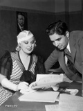 Mae West smiling in Casual Dress with Man Photo by  Movie Star News