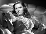 Ella Raines on a Ruffled Dress sitting Photo by  Movie Star News
