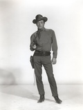 Robert Mitchum standing in Cowboy Outfit Photo by  Movie Star News