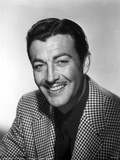 Robert Taylor smiling in Checkered Suit Photo by  Movie Star News