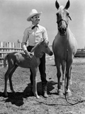 Gene Autry smiling with a Horse and Pony Photo by  Movie Star News