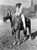Howard Keel Riding Horse in White Outfit Photo by  Movie Star News