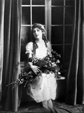 Mary Pickford sitting and Carrying Flowers Photo by  Movie Star News