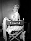 Kim Novak Siting on Chair in White Gown Photo by  Movie Star News