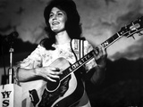Loretta Lynn Playing Guitar in Classic Photo by  Movie Star News
