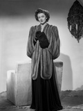 Myrna Loy standing in Robe with Gloves Photo by Gaston Longet