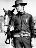Clint Eastwood Holding Horse in Classic Photo by  Movie Star News