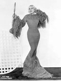 Mae West standing in Classic Long Gown Photo by  Movie Star News