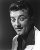 Robert Mitchum Posed and smiling in Suit Photo by  Movie Star News