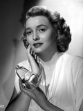 Patricia Neal Holding Perfume in Dress Photo by  Movie Star News