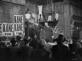 Citizen Kane Man in Black Suit with Cast Photo by  Movie Star News