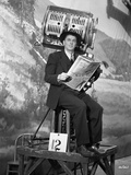 Ronald Reagan Reading Newspaper in Suit Photo by  Movie Star News