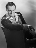 Orson Welles sitting in Black and White Photo by E Bachrach