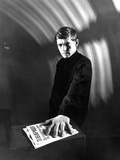 Tom Courtenay in Black Suit With Newspaper Photo by  Movie Star News