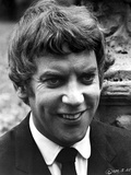 Donald Sutherland smiling in Black Suit Photo by  Movie Star News
