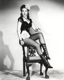 Ann Miller sitting in Classic Portrait Photo by  Movie Star News