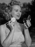 Virginia Mayo Powdering Face in Portrait Photo by  Movie Star News