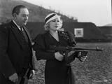 Mae West Holding a Gun with Man Behind Her Photo by  Movie Star News