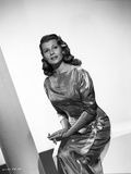 Rita Hayworth Posed with a Shiny Gown Photo by Robert Coburn