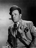 Wallace Beery standing in Suit With Hat Photo by  Movie Star News