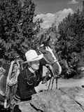Gene Autry Hiding Behind a Big Rock Photo by  Movie Star News