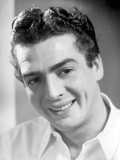 Victor Mature smiling in White Polo Photo by  Movie Star News