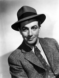 Robert Taylor Posed in Suit and Hat Photo by  Movie Star News