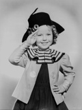 Shirley Temple Saluted in Black Hat Photo by  Movie Star News