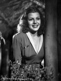 Rita Hayworth smiling Behind a Tree Photo by  Movie Star News