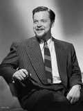 Orson Welles smiling in Coat and Tie Photo by E Bachrach