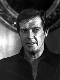 Roger Moore in Black With Black and White Photo by  Movie Star News