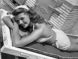 Rita Hayworth smiling and Sunbathing Photo by  Movie Star News