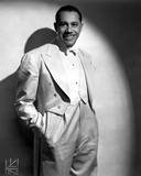 Cab Calloway standing in White Suit Photo by  Movie Star News