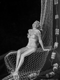 Rita Hayworth Seated on Fishing Net Photo by  Movie Star News