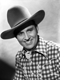 Gene Autry smiling in Western Outfit Photo by  Movie Star News