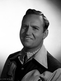 Gene Autry smiling in Western Attire Photo by  Movie Star News